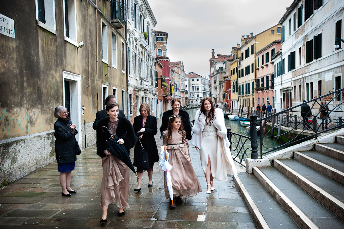 Italian wedding photographers, Venice, bride and bridesmaids beside a venetian canal