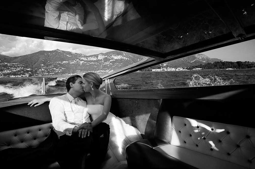 Italian wedding photographers, portfolio, Lake Como wedding, bride and groom kiss on boat
