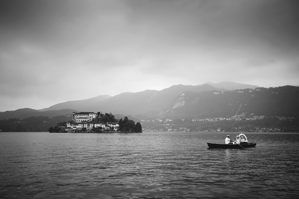 Lake Orta wedding photographer, Katie and Paul just married, bride on a rowing boat