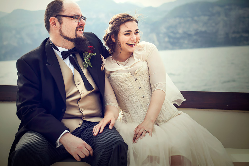 bride and groom on boat, Lake Garda wedding