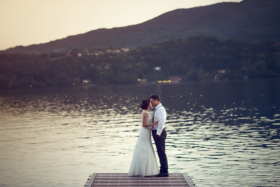 Romantic kiss on a jetty, Lake Orta wedding