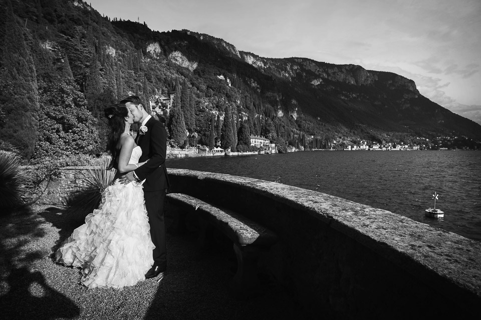 bride and groom kiss by Lake Como