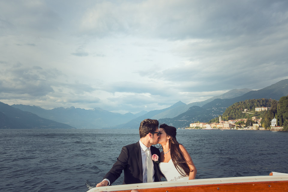 bride and groom kiss on boat