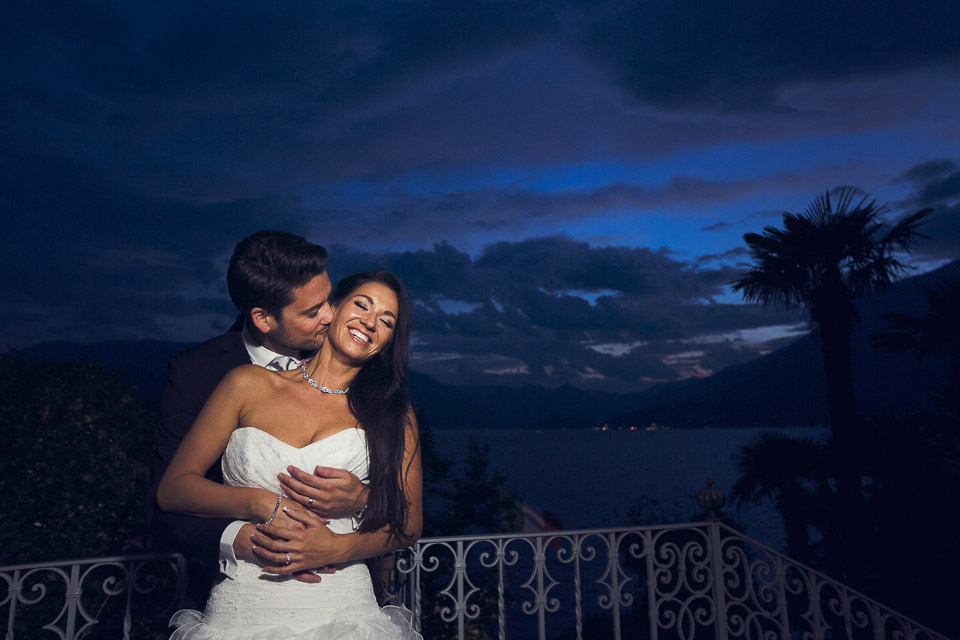 bride and groom kiss at the blue hour