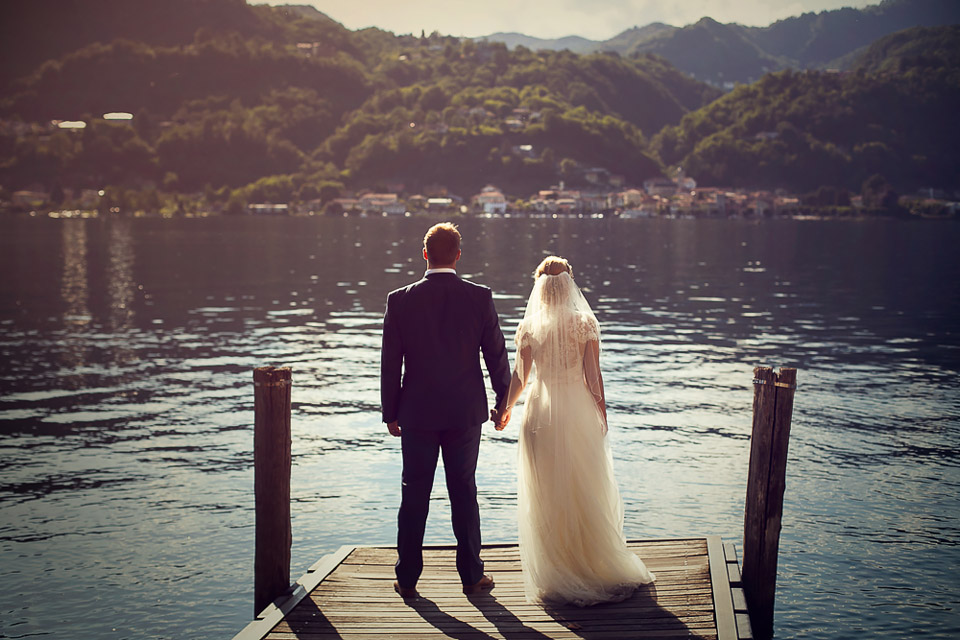 bride and groom looking at the lake