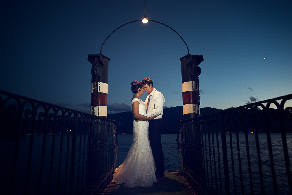 bride and groom at the sunset by the lake