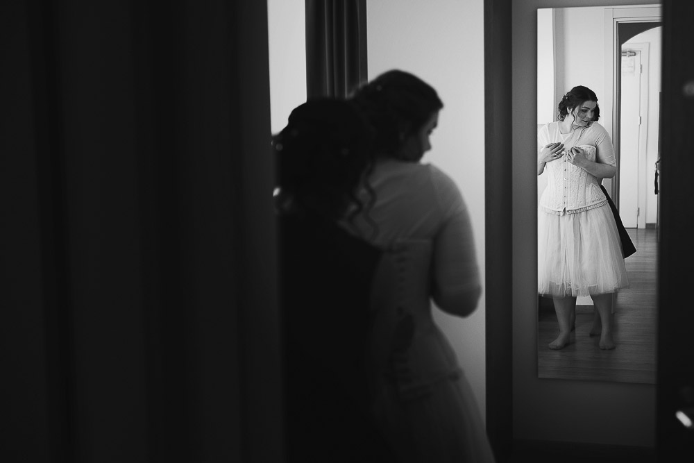 the bride and mirror reflection