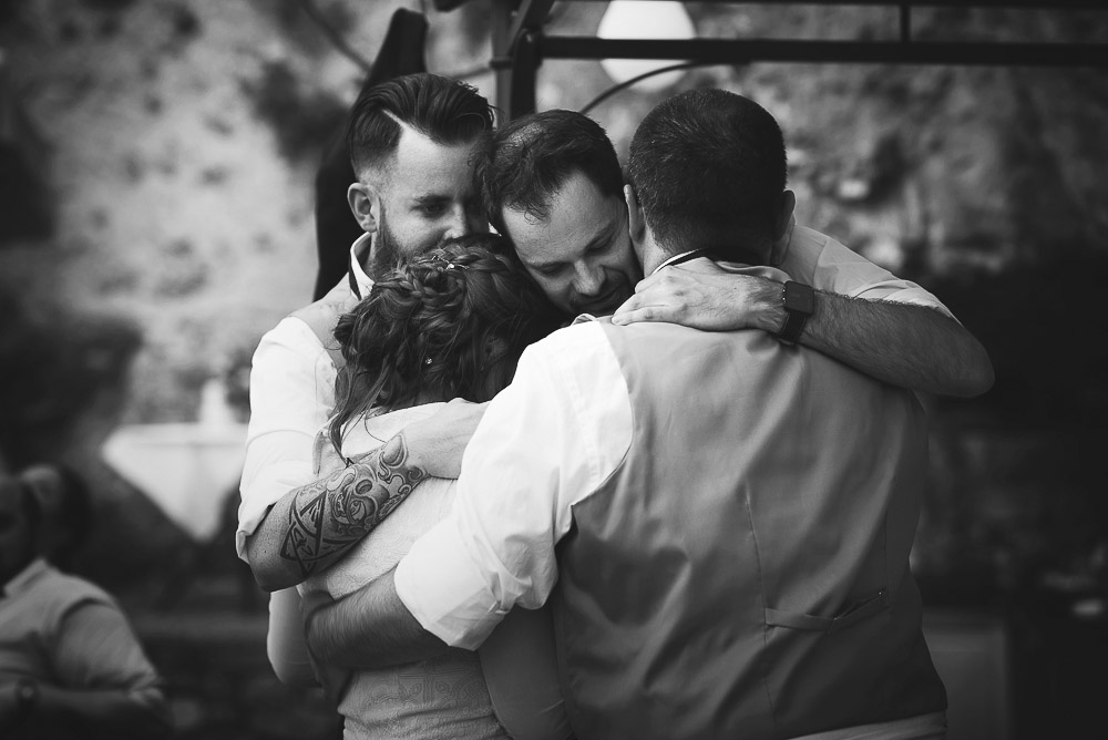 bets men hug bride and groom