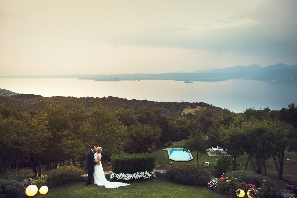 bride and groom overlooking Lake Garda