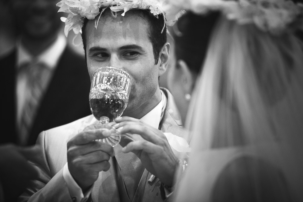 groom drinks wine at the ceremony