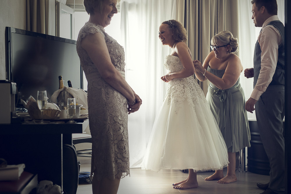 bride's mother helps to get ready