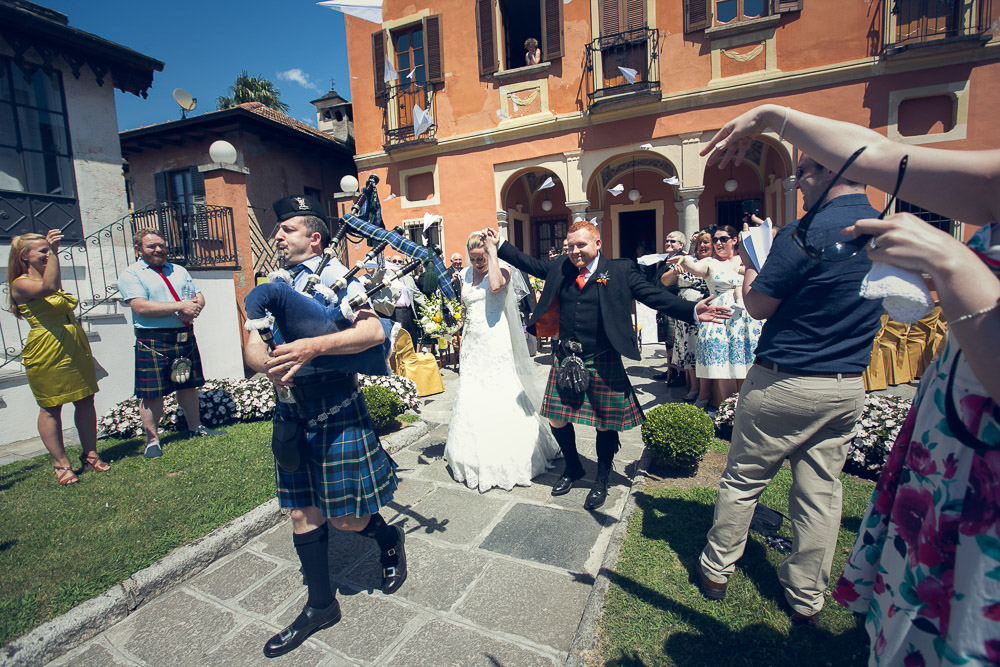 Scottish piper and newlyweds