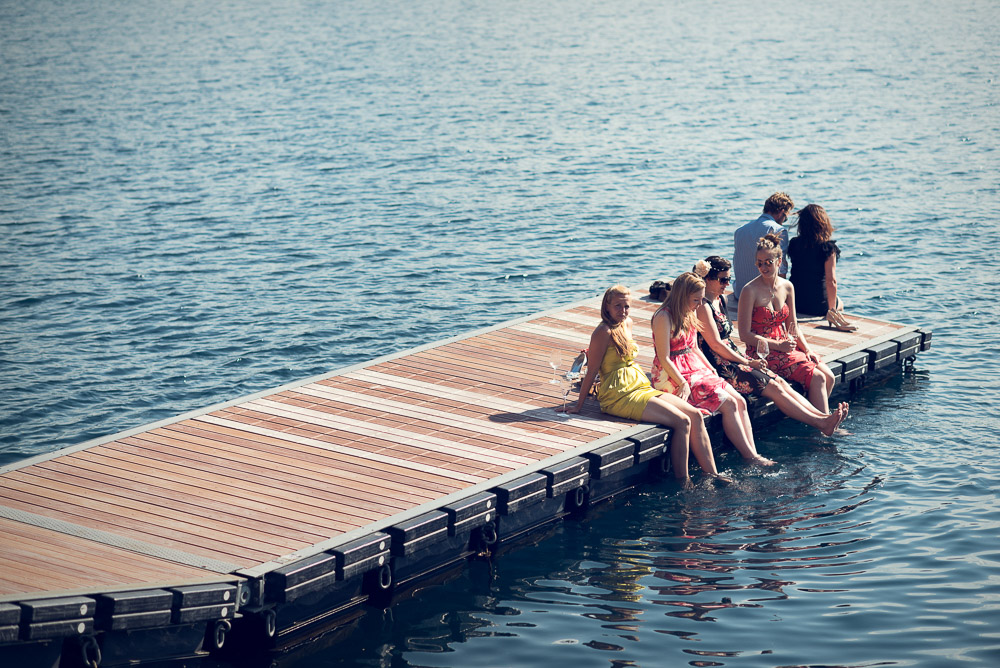 Ladies with feet in the lake