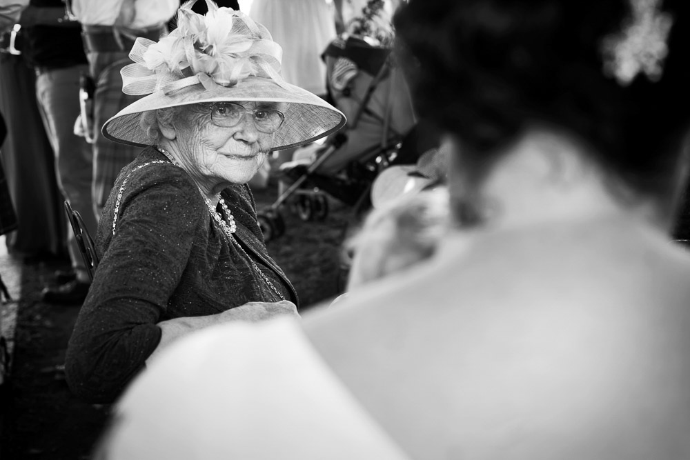 Grandmother is looking at the bride