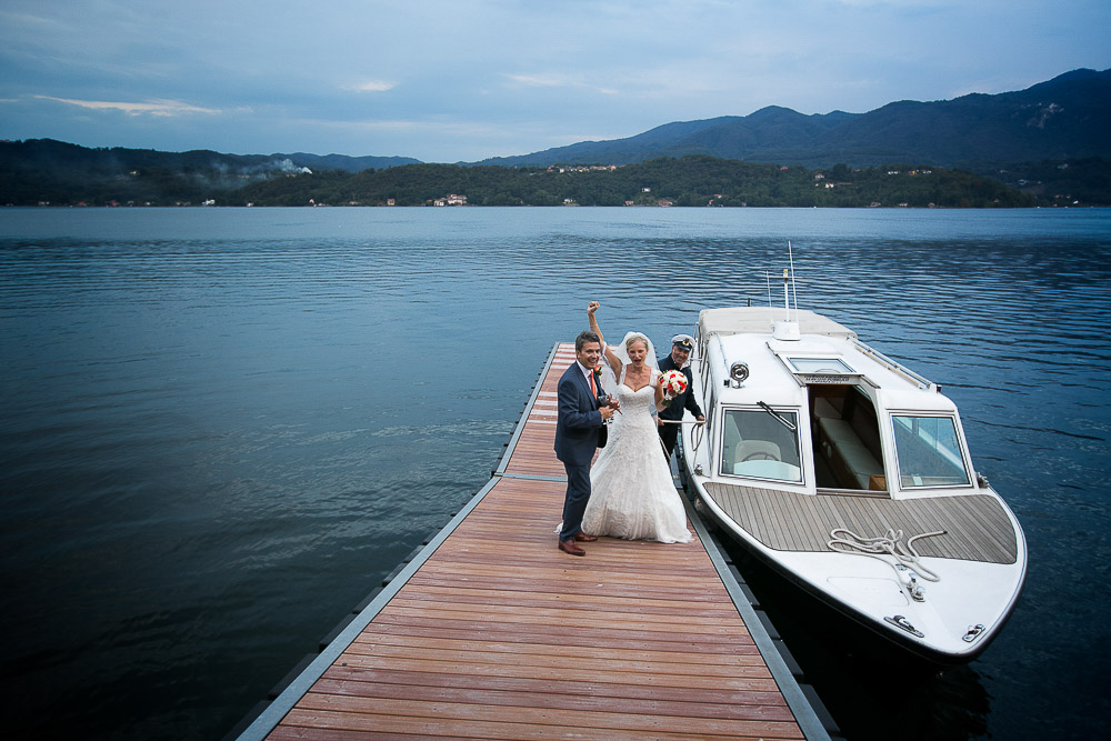 bride an groom on a jetty, lake orta