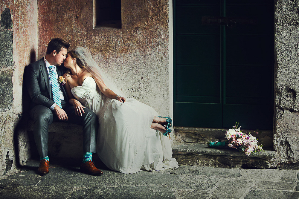Italian wedding photographers, bride and groom kiss, Lake Orta wedding