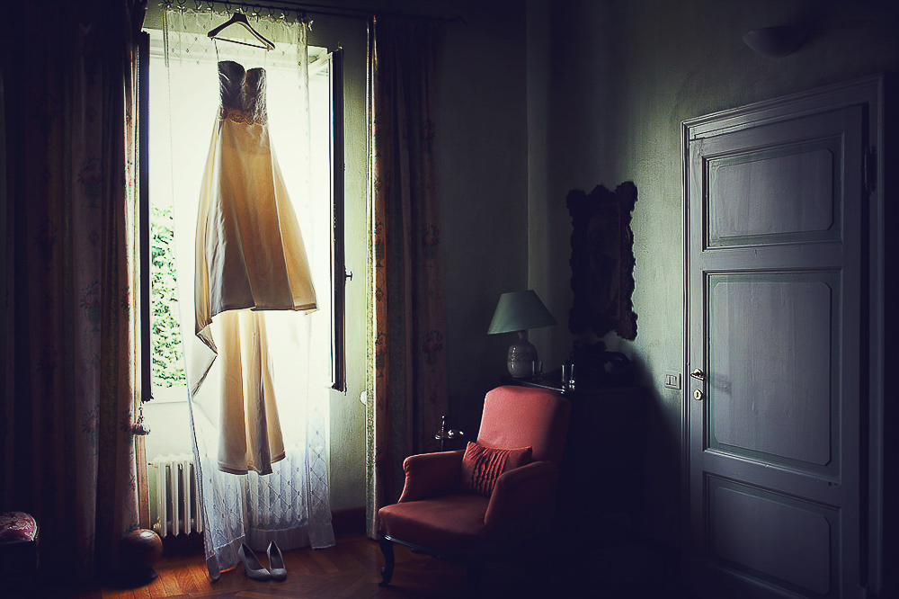 Italian wedding photographers, Lake Orta, bride's hanging dress ready to be dressed.