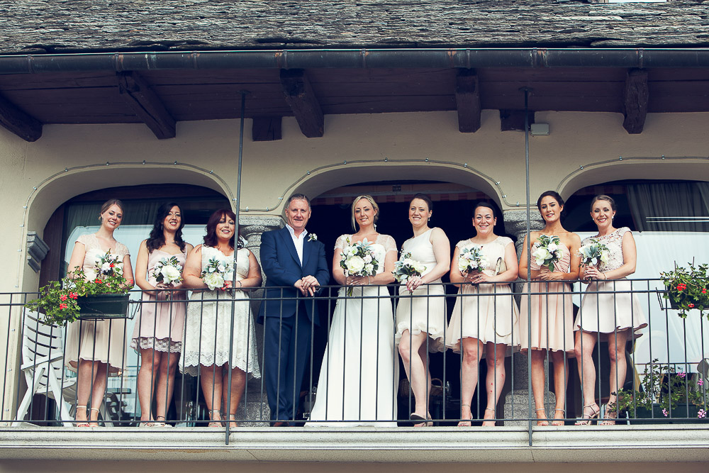 bride with her father and seven bridesmaids