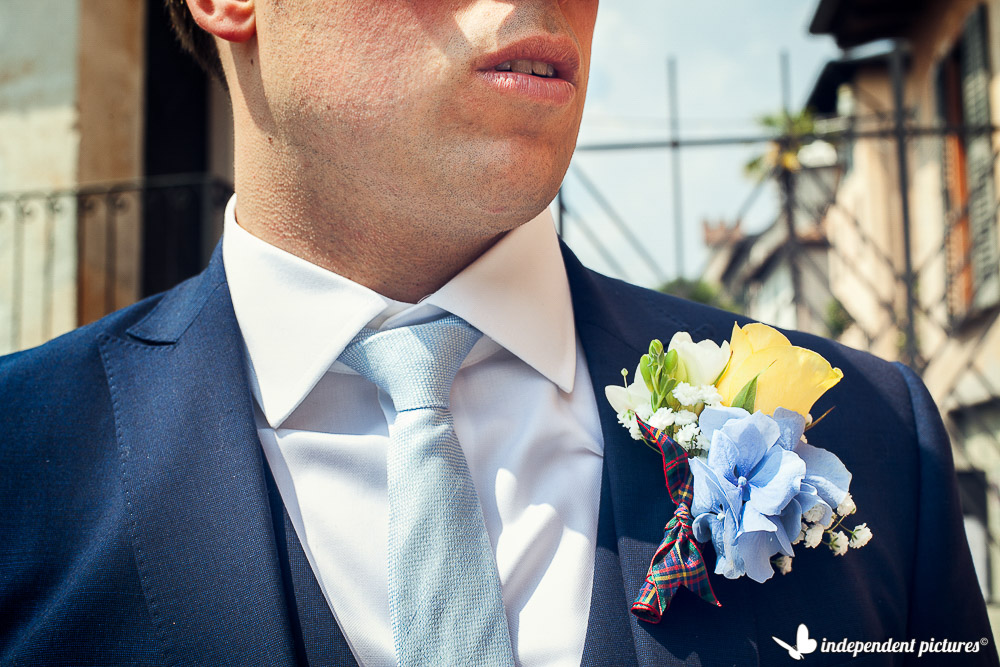 yellow and blue groom's boutonniere