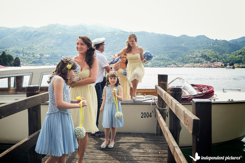 brides and flower girl reaching ceremony by boat