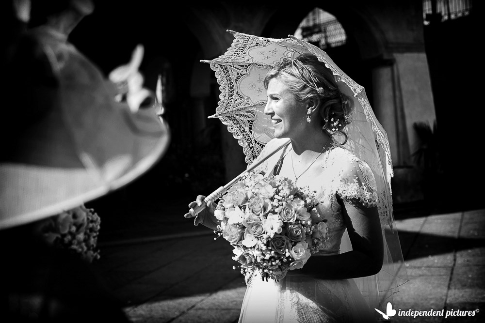 the bride with a sun umbrella