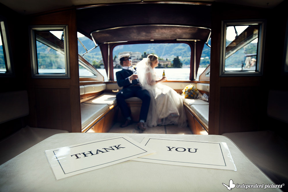 bride and groom on boat drinking prosecco