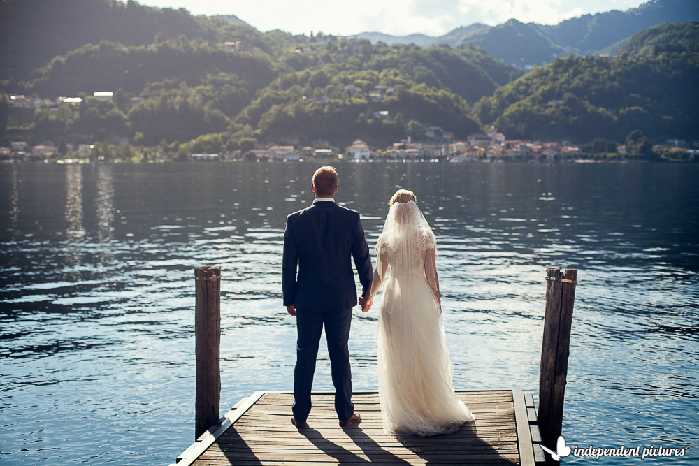 bride and groom on an Orta's shore
