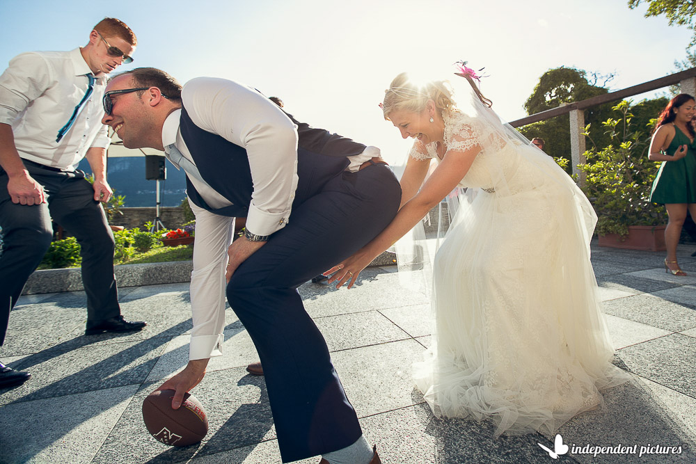 playing american football at the wedding