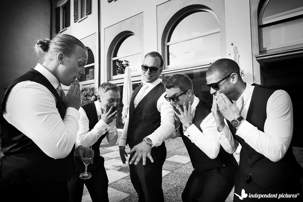 groom shows his ring to groomsmen