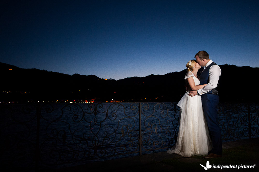 bride and groom on lake orta at the blue hour