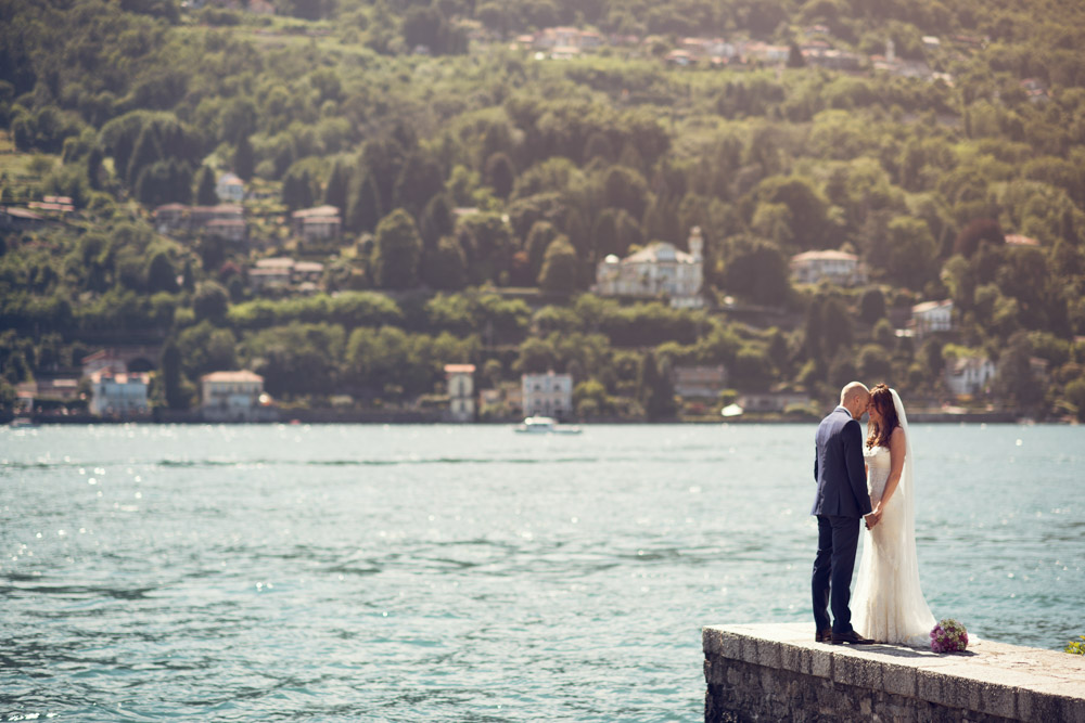 bride and groom by the lake maggiore shore