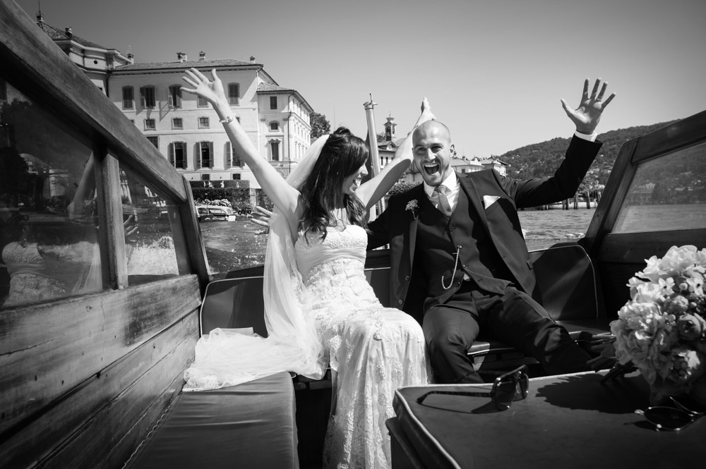 bride and groom are happy on boat