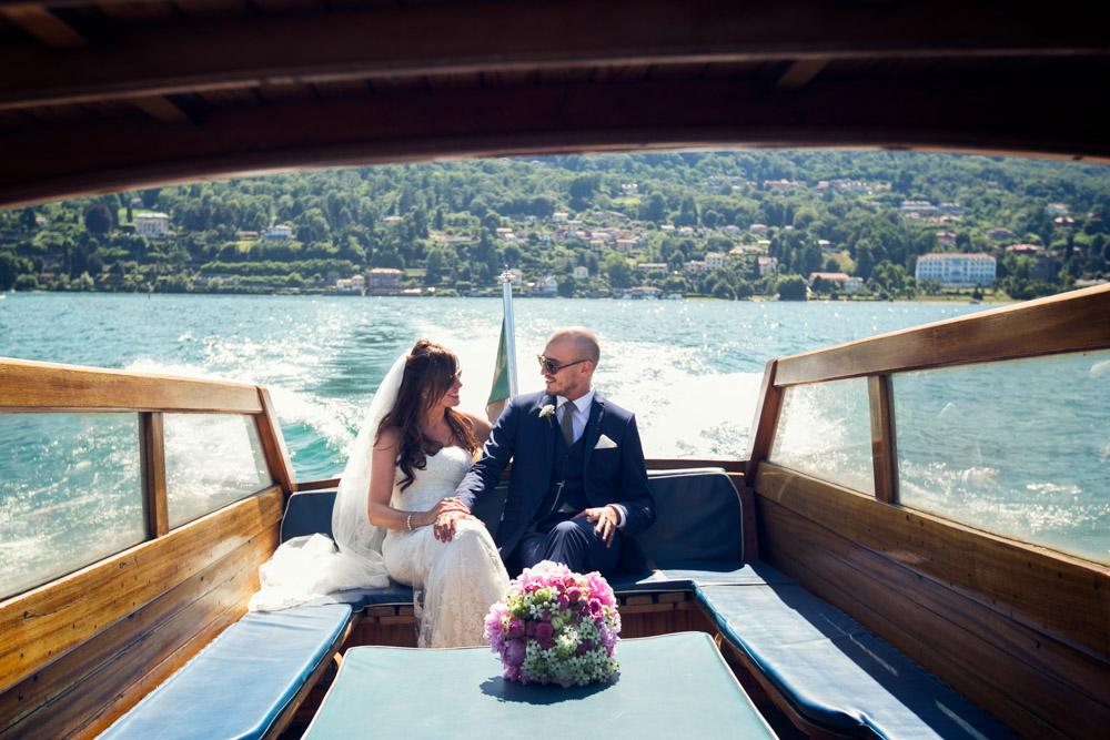 bride and groom are reaching the villa by boat