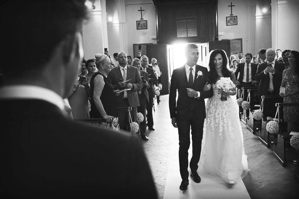 bride walks the aisle with her father