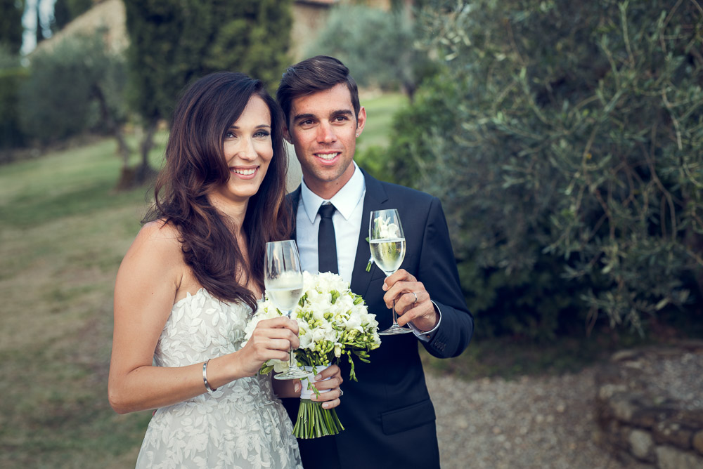 bride and groom open aperitifs with prosecco