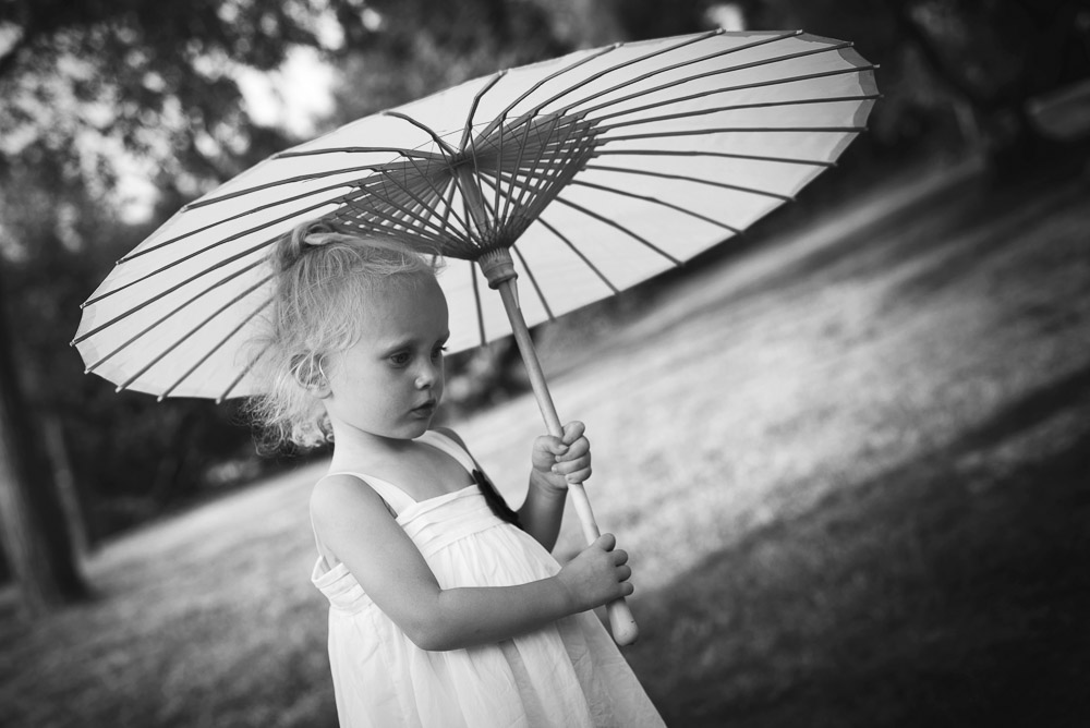 flower girl with sun umbrella