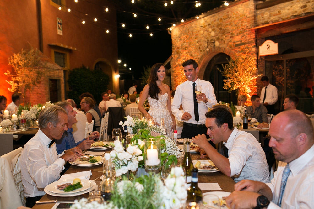 bride and groom among tables