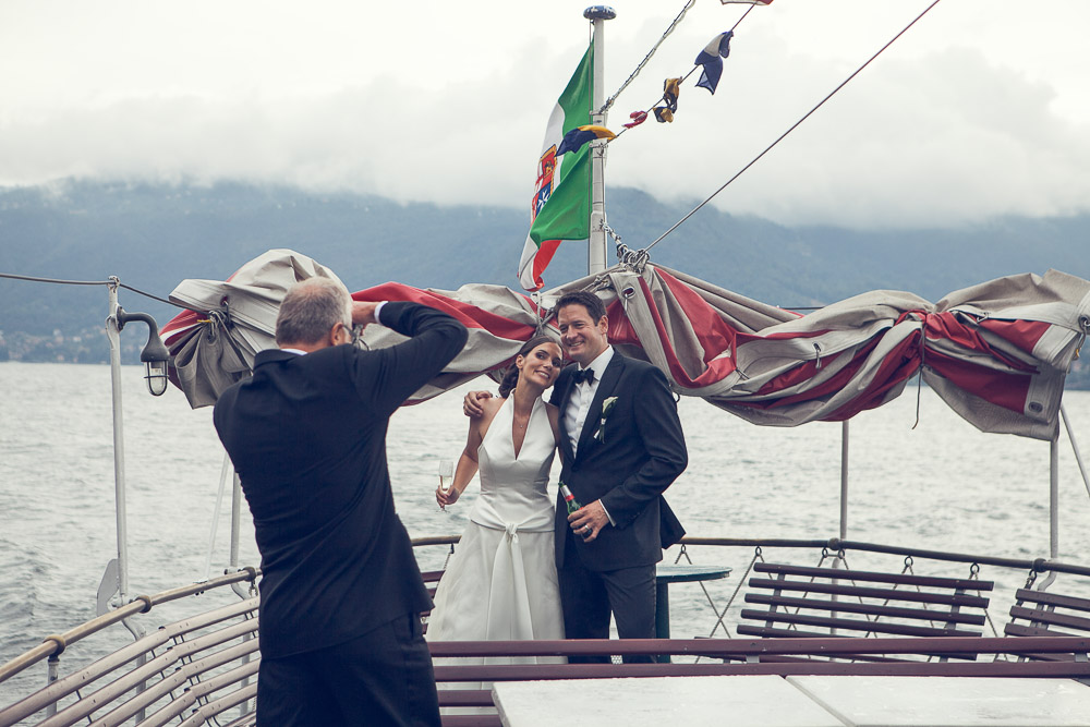 newlyweds on boat lake como