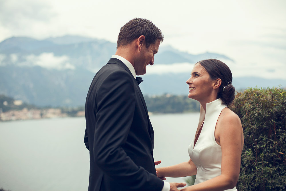 bride and groom by lake como