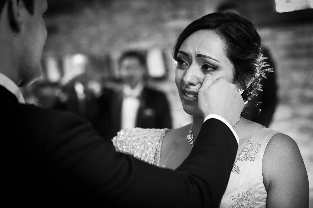 bride is cying during the ceremony