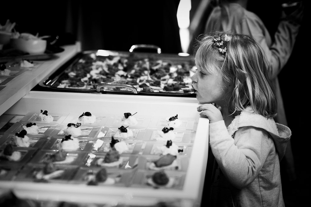 little girl looking at canapes