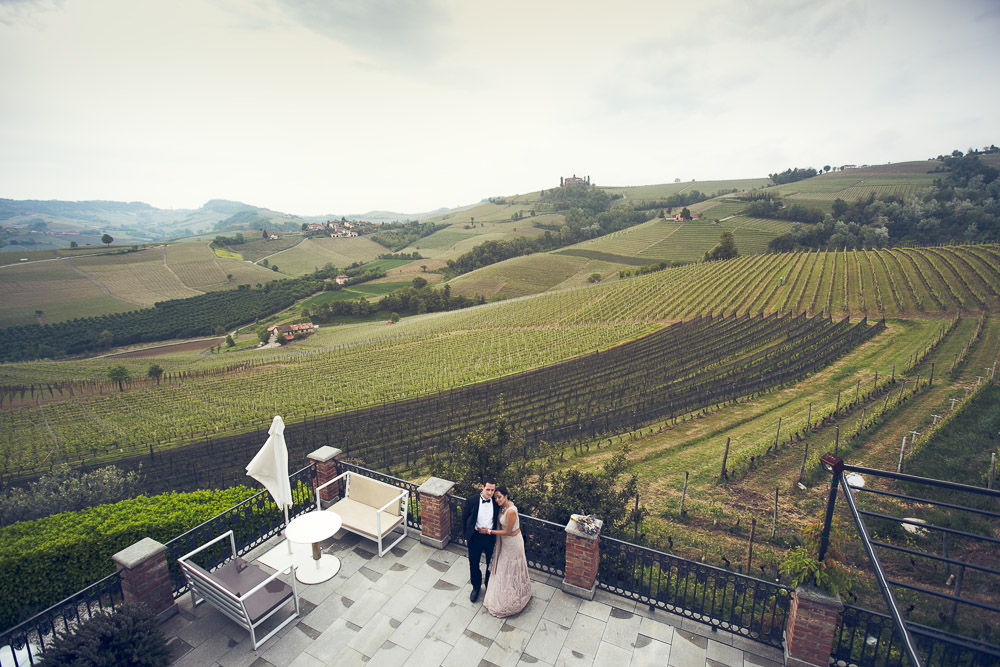 bride and groom and vineyard hills