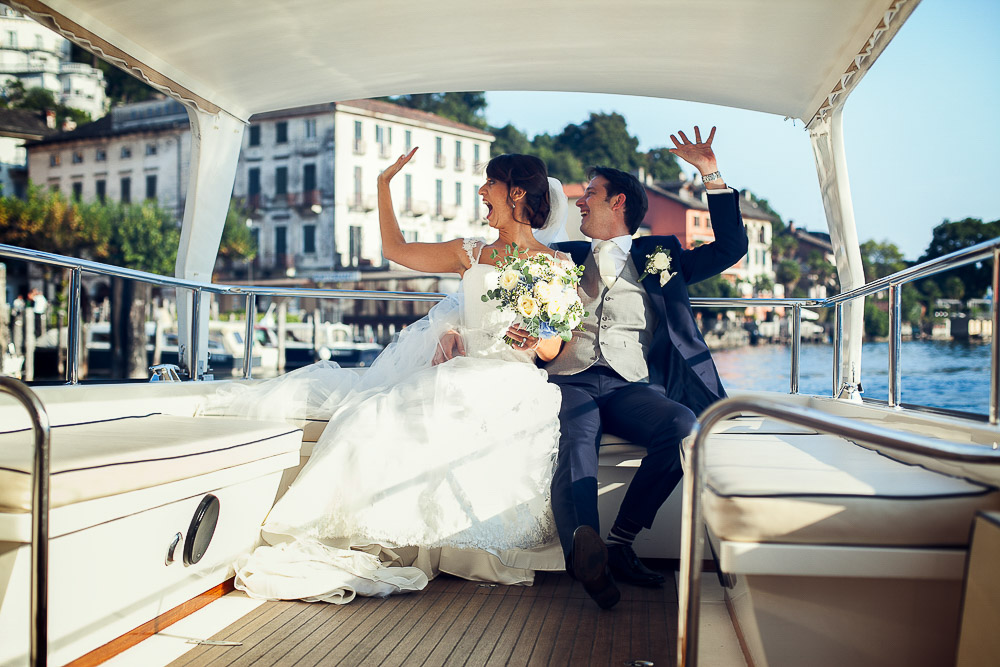 bride and groom on boat lake orta wedding