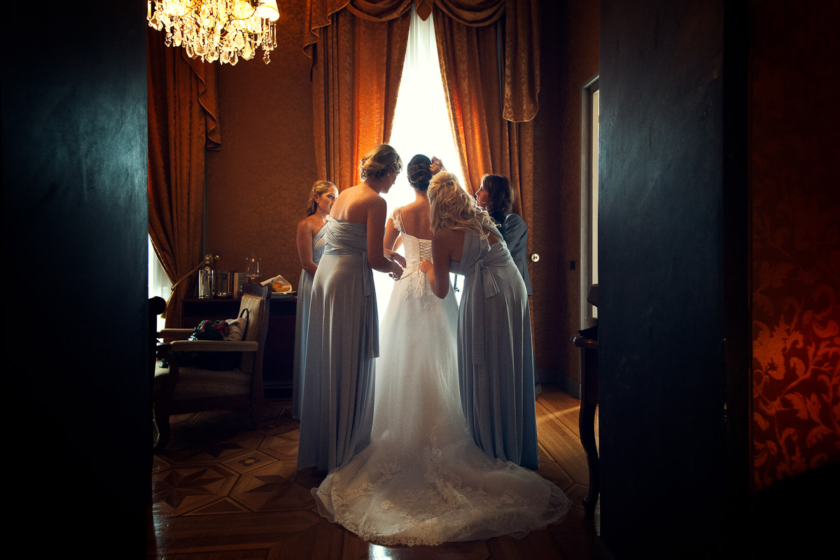 bride with bridesmaids getting ready In italy