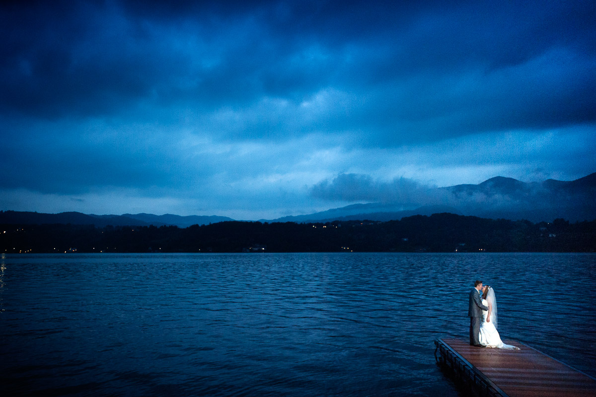 bride and groom kiss on jetty, lake orta wedding