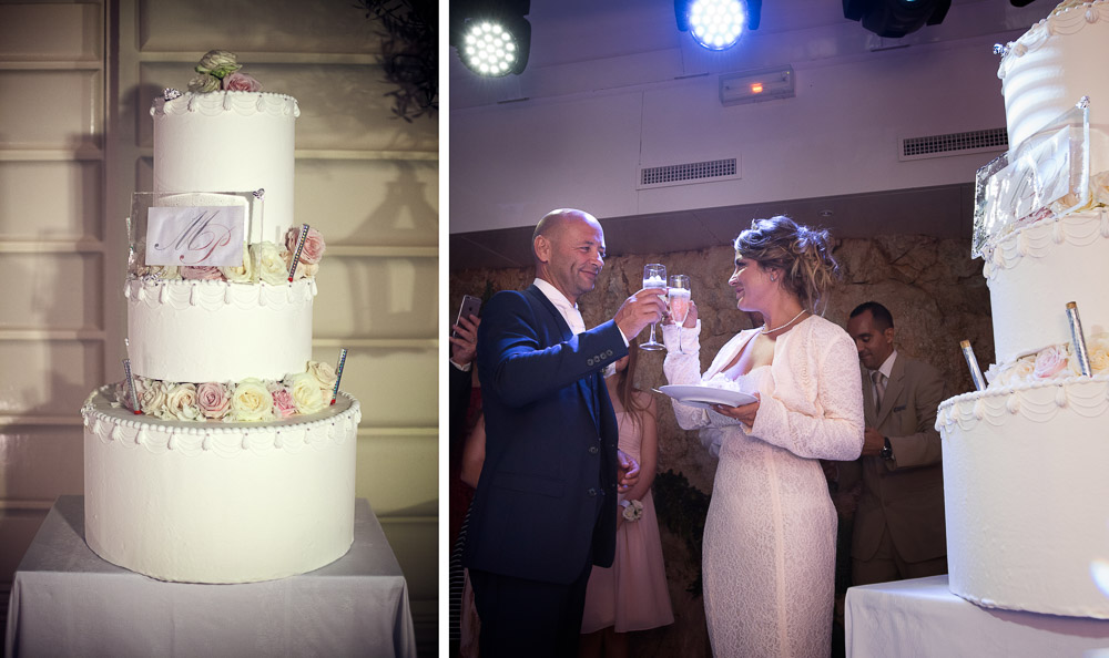 bride and groom toast with wedding cake