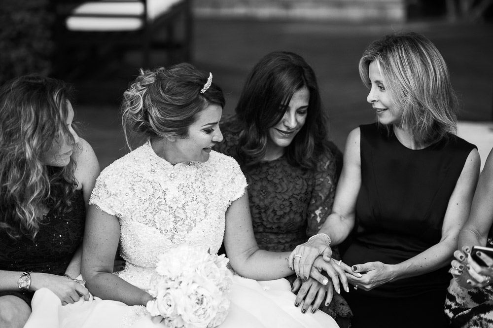 bride shows her wedding ring to the ladies