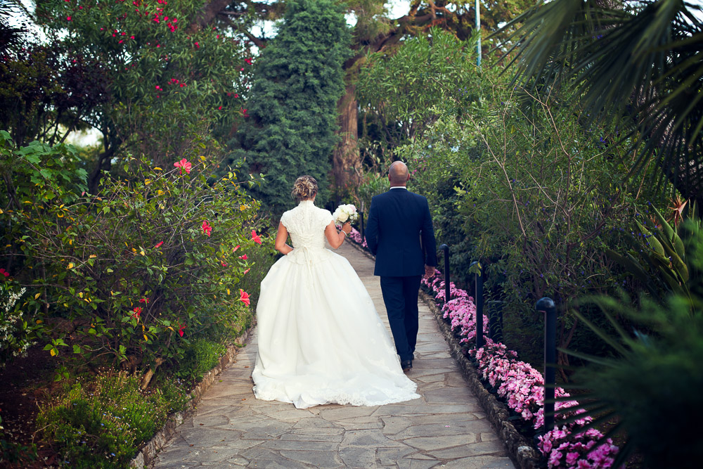 bride and groom walking the path