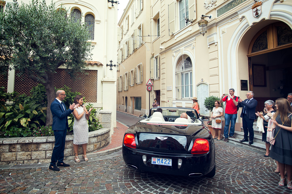 bride and groom leaving Monaco town hall