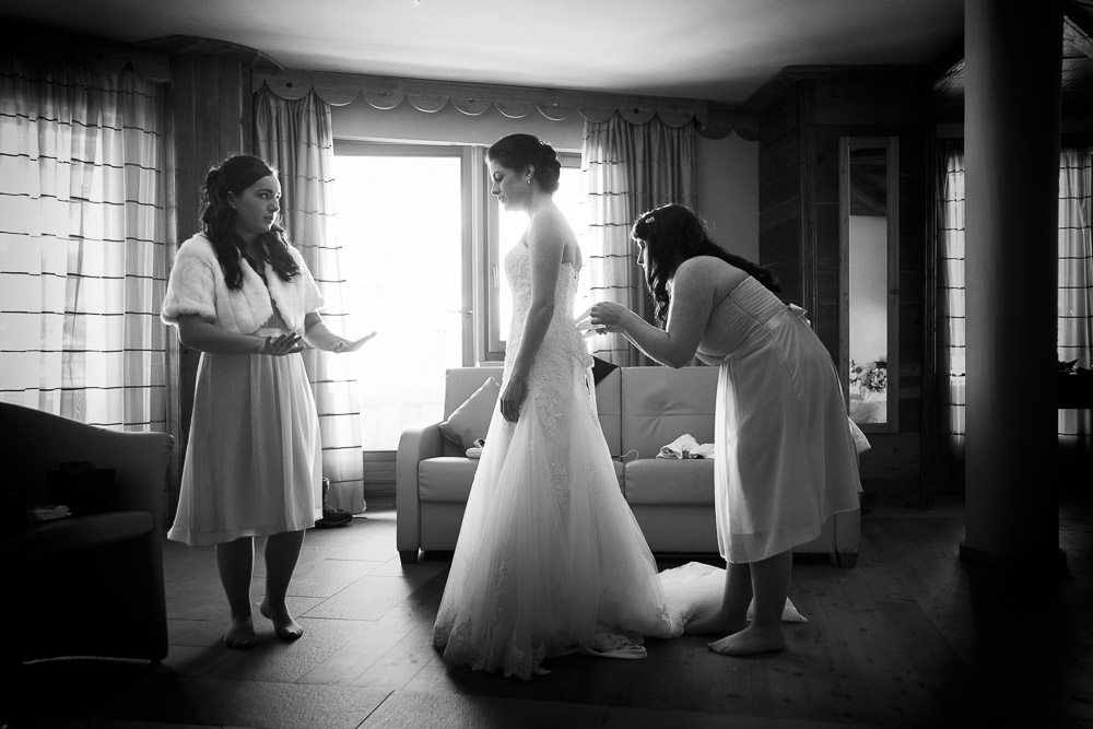 bridesmaids helping bride to get ready